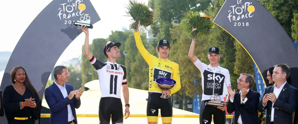 PHOTO: Winner Geraint Thomas (C) of Great Britain, Second Placed Tom Dumoulin (L) of The Netherlands and third placed Chris Froome (R) of Great Britain celebrate on the podium of the Tour de France in Paris, July 29, 2018.
