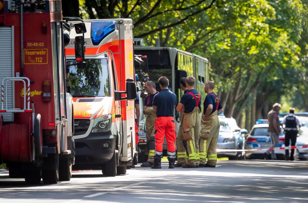 PHOTO: Emergency response stand near the scene where a person had allegedly attacked passengers on a bus in Luebeck, Germany, July 20, 2018.