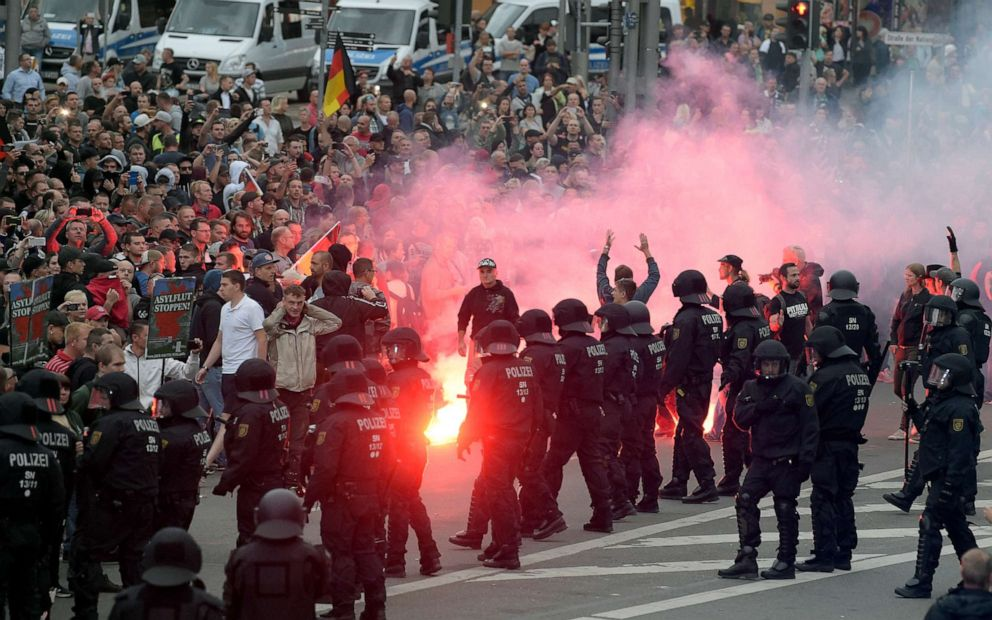 PHOTO: In this Aug 27, 2018, file photo, protesters light fireworks during a far-right demonstration in Chemnitz, Germany.