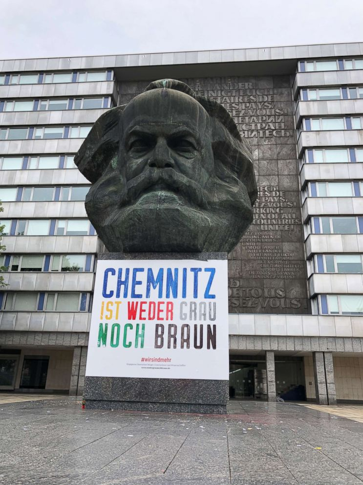 PHOTO: A sign requesting tolerance is pasted on a statue of Karl Marx in Chemnitz, Germany, Sept. 1, 2018.
