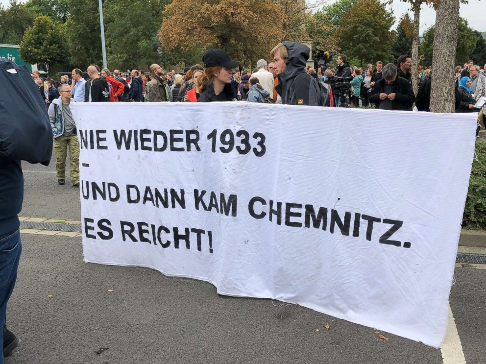 PHOTO: Protesters in an an anti-violence counter-demonstration hold up a sign Never again 1933. And then there was Chemnitz - a reference to Nazi-era Germany in Chemnitz, Germany, Sept. 1, 2018.
