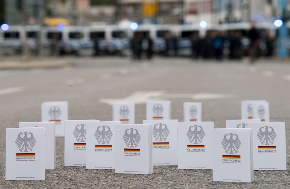 PHOTO: Numerous editions of the Federal Constitutional Law (Grundgesetz) are placed in the street by supporters of the alliance Chemnitz Nazifrei (Chemnitz without Nazis) near the location of a counter-march in Chemnitz, Germany, on Sept. 1, 2018.