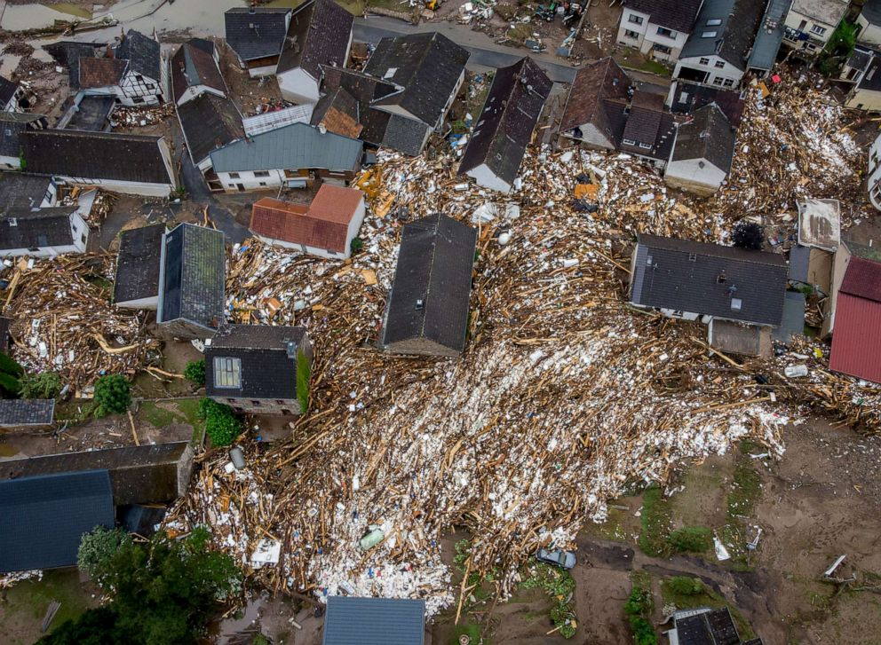 PHOTO: Debris of houses and trees surround houses in Schuld, Germany, July 16, 2021.