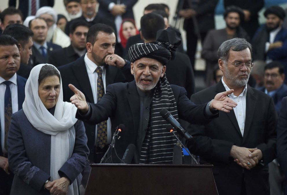 PHOTO: Afghan President Ashraf Ghani (C) speaks to media as Afghan First Lady Rula Ghani (L) and Sarwar Danish his current second vice president (R) look on at the Independent Electoral Commission office in Kabul, Jan. 20, 2019.