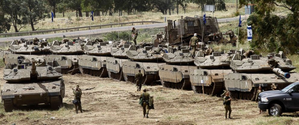 PHOTO: Israeli soldiers walk by Merkava Mark IV tanks during a military drill in the Israeli-annexed Golan Heights on May 1, 2018.