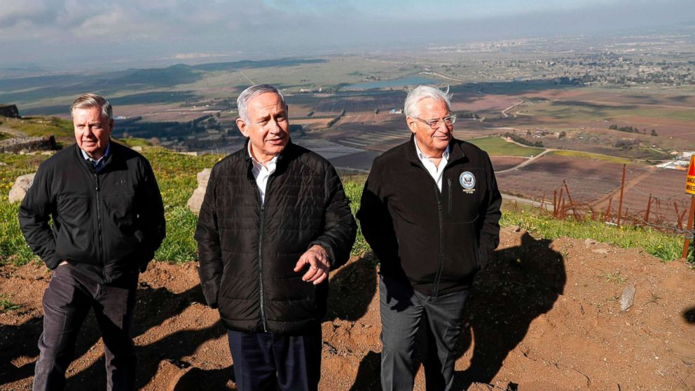 Sen. Lindsey Graham is accompanied by Israeli Prime minister Benjamin Netanyahu and U.S. Ambassador to Israel David Friedman as they visit the border line between Syria and the Israeli-annexed Golan Heights on March 11, 2019.