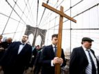 PHOTO: Vladimir Kuzman carries a wooden cross while leading the 23rd annual Way of the Cross over the Brooklyn Bridge to mark the Good Friday holiday in New York, March 30, 2018.