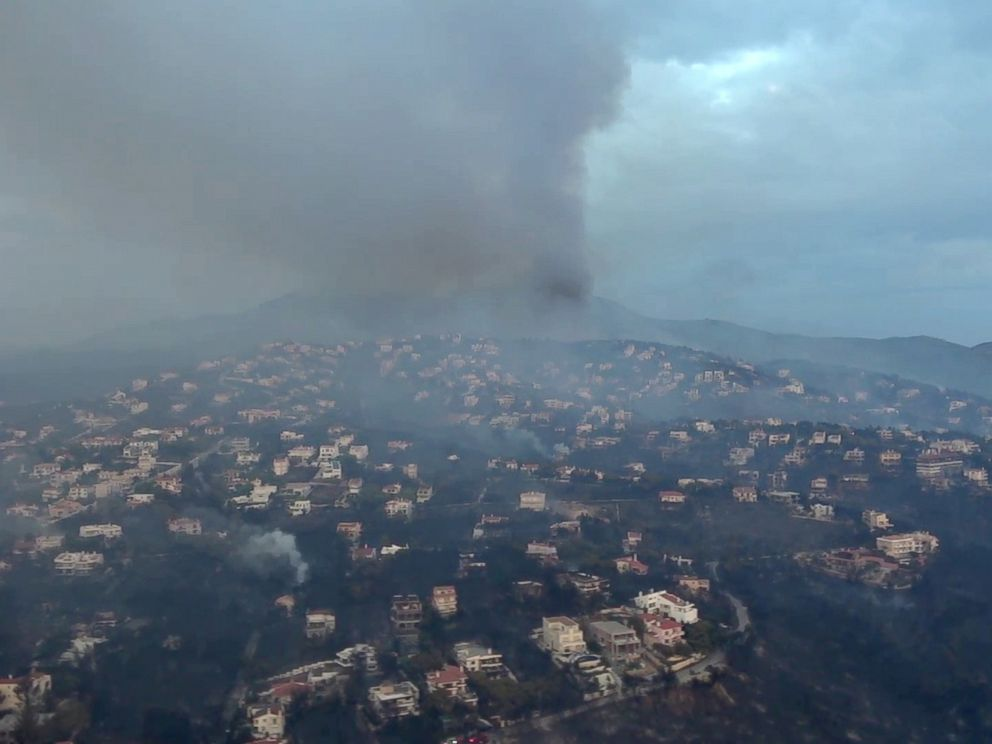 PHOTO: This handout picture released by the Hellenic Ministry of Defense on July 24, 2018 shows an aerial view of the fire in Mati, Greece.