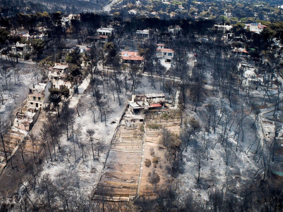 PHOTO: An aerial view shows burnt houses and trees following a wildfire in the village of Mati, near Athens, Greece, July 25, 2018.