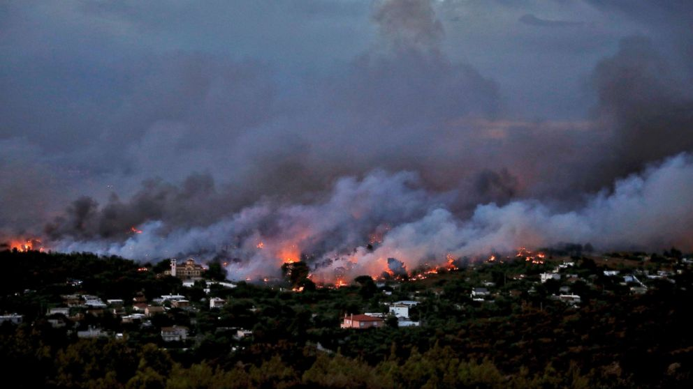 A wildfire rages in the town of Rafina, near Athens, July 23, 2018.