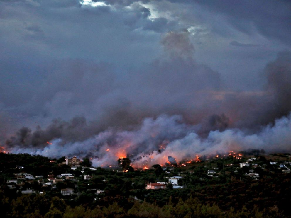 PHOTO: A wildfire rages in the town of Rafina, near Athens, July 23, 2018.