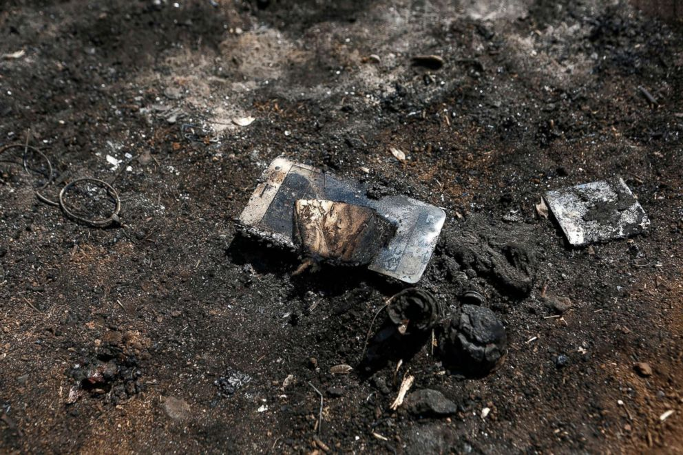 PHOTO: A victims burned mobile phone is seen following a deadly forest fire in Mati a northeast suburb of Athens, Greece, July 25, 2018.
