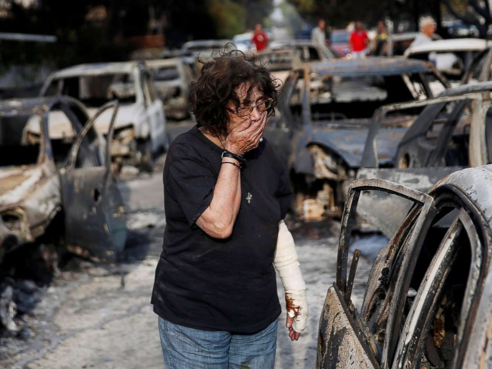 PHOTO: A woman reacts as she tries to find her dog, following a wildfire at the village of Mati, near Athens, Greece, July 24, 2018.