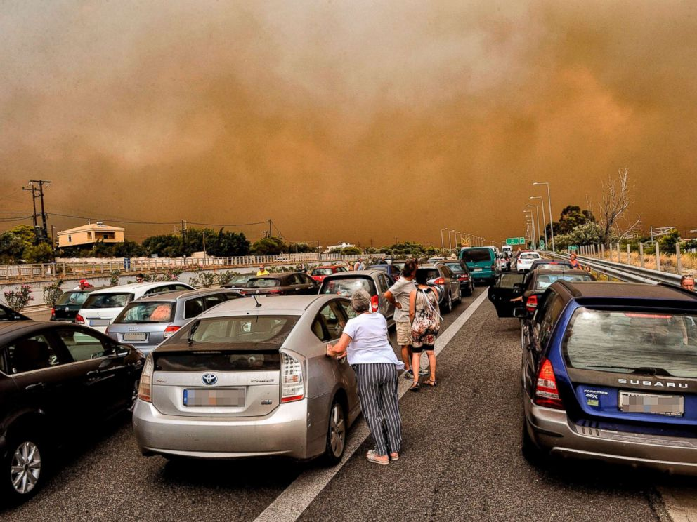 PHOTO: Cars are blocked at the closed National Road during a wildfire in Kineta, near Athens, July 23, 2018.