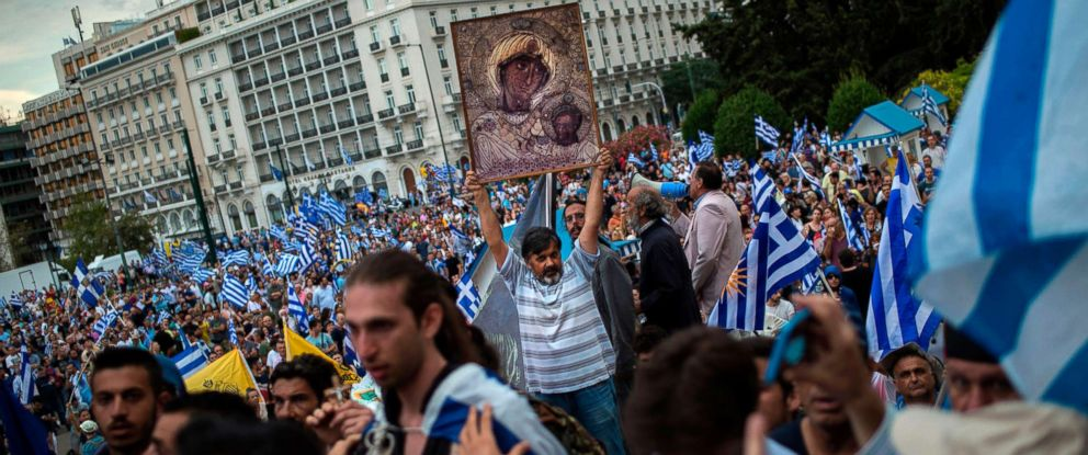 PHOTO: A man holds an icon during a demonstration on June 16, 2018 in Athens, Greece, against the agreement reached to resolve a 27-year name row with Macedonia.