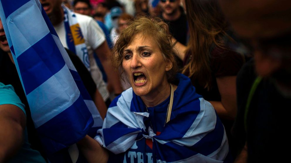 A woman shouts in a demonstration against the agreement reached to resolve a 27-year name row with Macedonia in Athens, Greece, June 16, 2018.