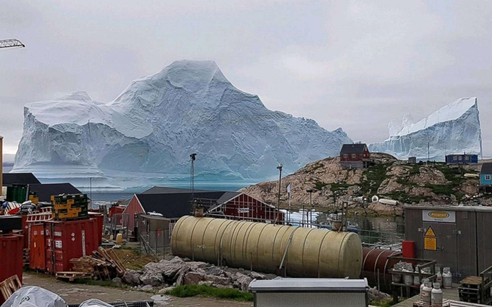 PHOTO: An iceberg floats near the Innaarsuit settlement, Greenland, July 12, 2018.