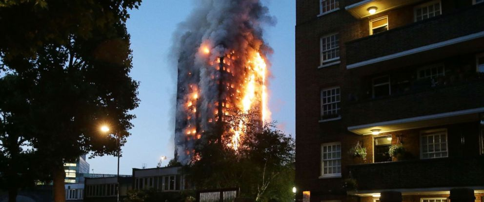 PHOTO: In this file photo taken on June 14, 2017 police man a security cordon as a huge fire engulfs the Grenfell Tower early June 14, 2017 in west London.