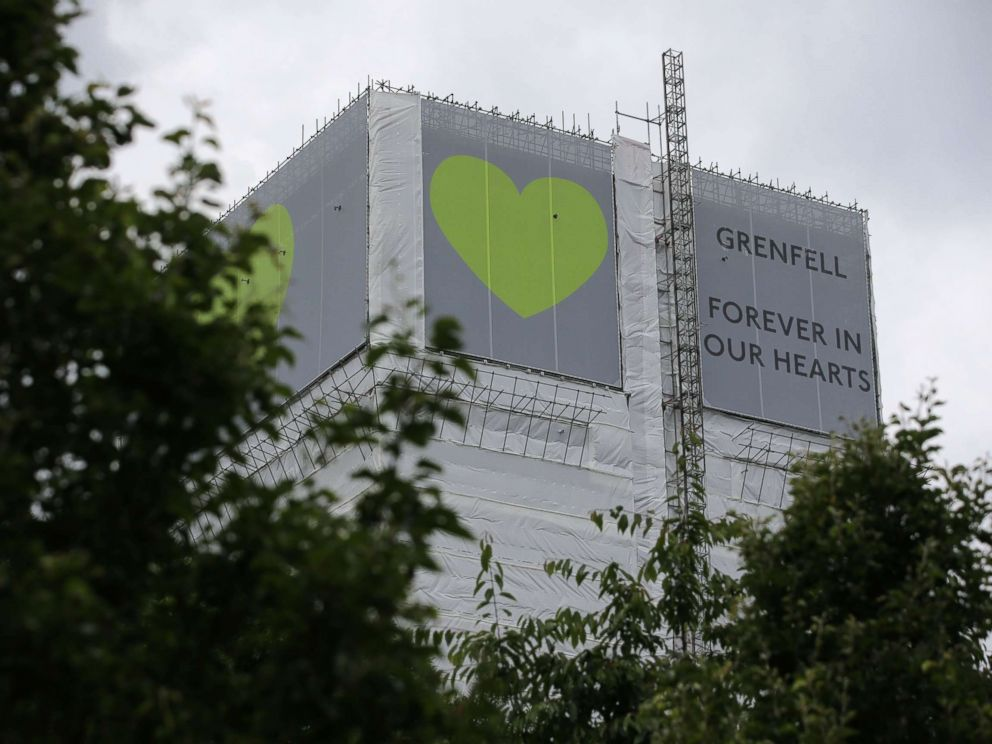 PHOTO: A sign in support of the victims of the Grenfell fire covers Grenfell Tower near Ladbroke Grove, west London on June 13, 2018.