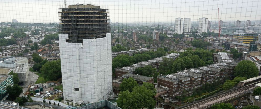 PHOTO: Scaffolding covers the burnt out Grenfell Tower, almost one year on from the fire that killed 72 people, in London, May 30, 2018.