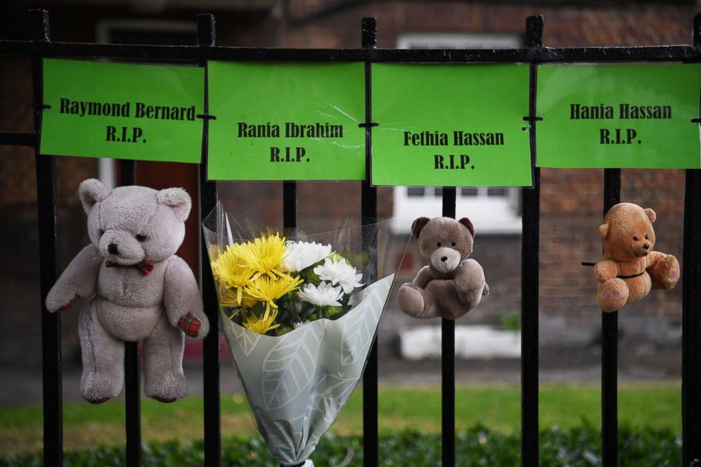 PHOTO: Tributes to victims of the Grenfell fire are displayed near the site of the tower bock in London, Britain, June 14, 2018, to mark the one year anniversary.