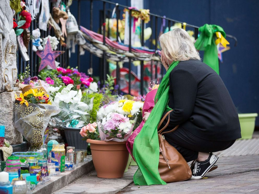 PHOTO: People pay their respects at Notting Hill Methodist Church during the Grenfell Tower Anniversary in London, June 14, 2018.