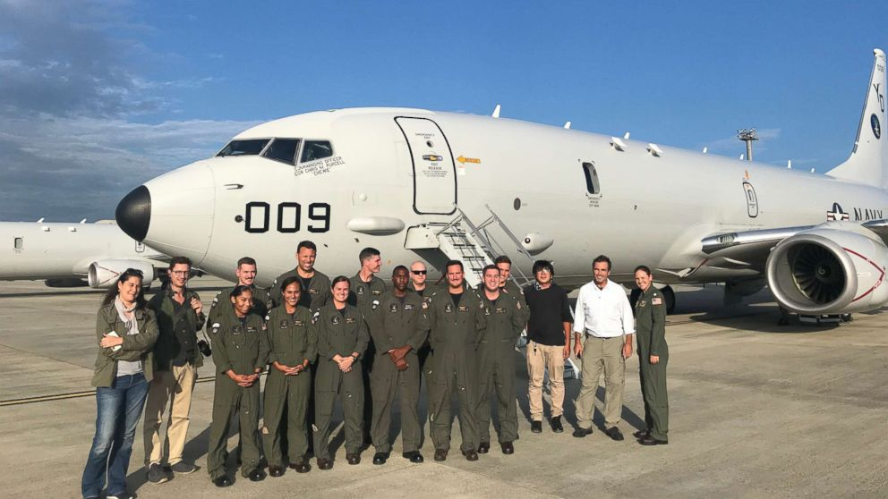 Reporters pose with members of U.S. Navy Maritime Patrol Squadron Four, in Okinawa, Japan, on Sep. 6, 2018.