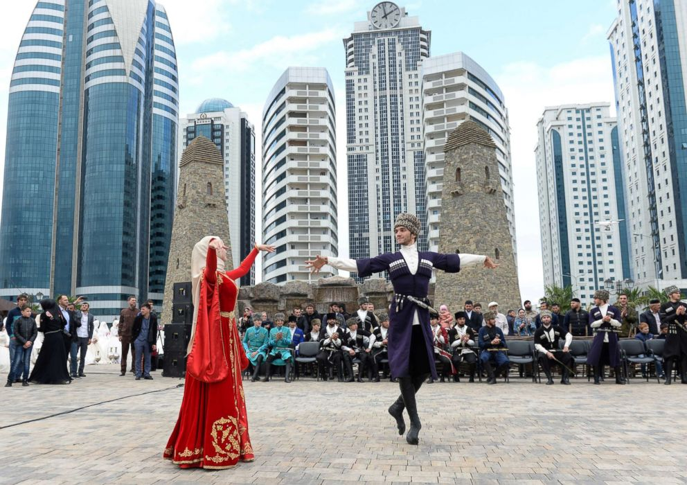 Dancers wearing traditional costumes perform during celebrations to mark the 200th anniversary of the Chechen capital of Grozny, Russia, Oct. 5, 2018.