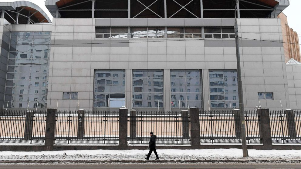 A man walks past the building of the headquarters of the Russian General Staff's Main Intelligence Department in Moscow on Dec. 30, 2016.