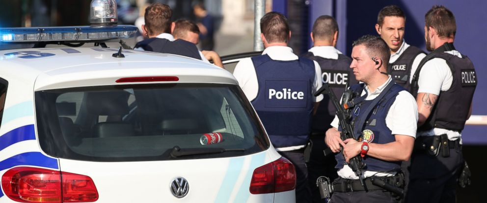 PHOTO: Police stand as they secure the area around a police building in the southern Belgian city of Charleroi following a machete attack on August 6, 2016.
