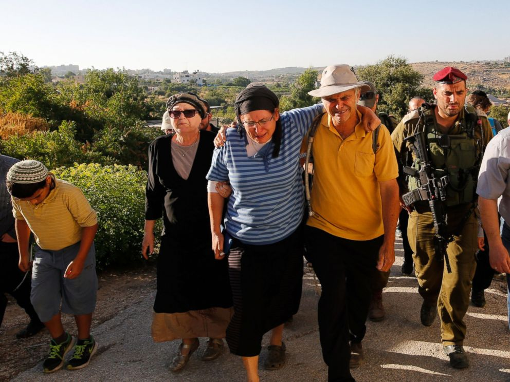 PHOTO: Rina (2-L) and Amihay Yaffe Ariel (3-R) parents of Israeli Hallel, a 13-year-old girl who was fatally stabbed by a Palestinian in her home, mourn during her funeral in Kiryat Arba, outside the West Bank city of Hebron on June 30, 2016.