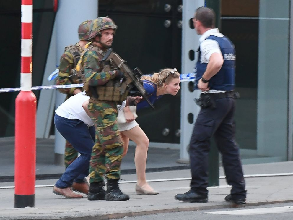 PHOTO: Soldiers and police officials guide members of the public on a street outside Gare Centrale in Brussels on June 20, 2017, after an explosion in the Belgian capital.