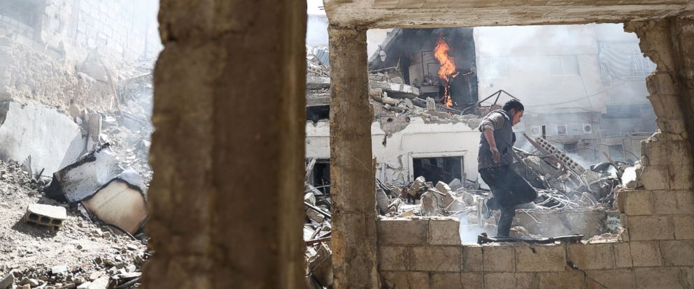 PHOTO: A Syrian man walks amid the rubble of destroyed buildings following reported government airstrike on the rebel-held town of Douma, on the eastern outskirts of the capital Damascus, Feb. 26, 2017.