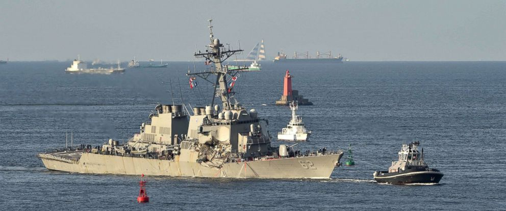 PHOTO: A tugboat leads the US Navy guided missile destroyer USS Fitzgerald sails into port at the US Naval Yokosuka Base, Kanagawa prefecture on June 17, 2017.