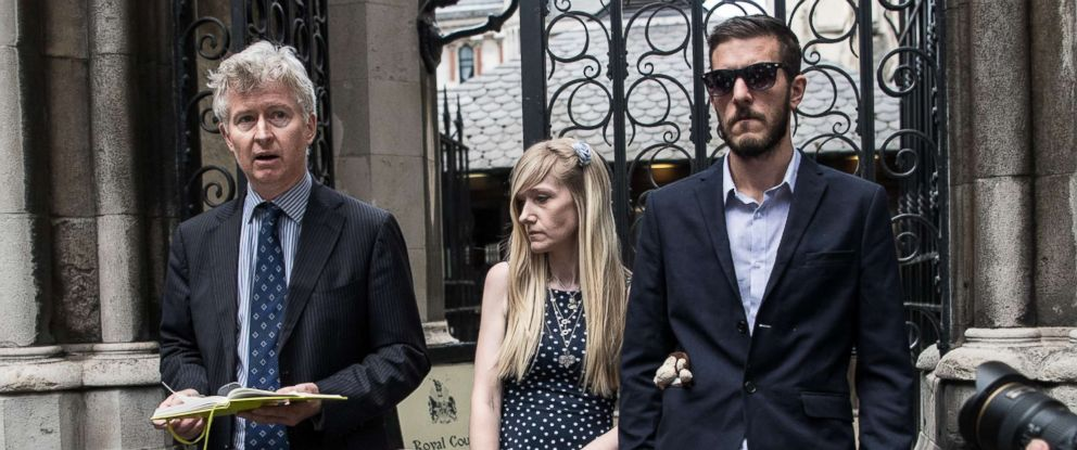 PHOTO: Chris Gard and Connie Yates, the parents of terminally ill toddler Charlie Gard, listen as family friend, Alasdair Seton-Marsden, left, addresses the media outside High Court on July 10, 2017 in London.