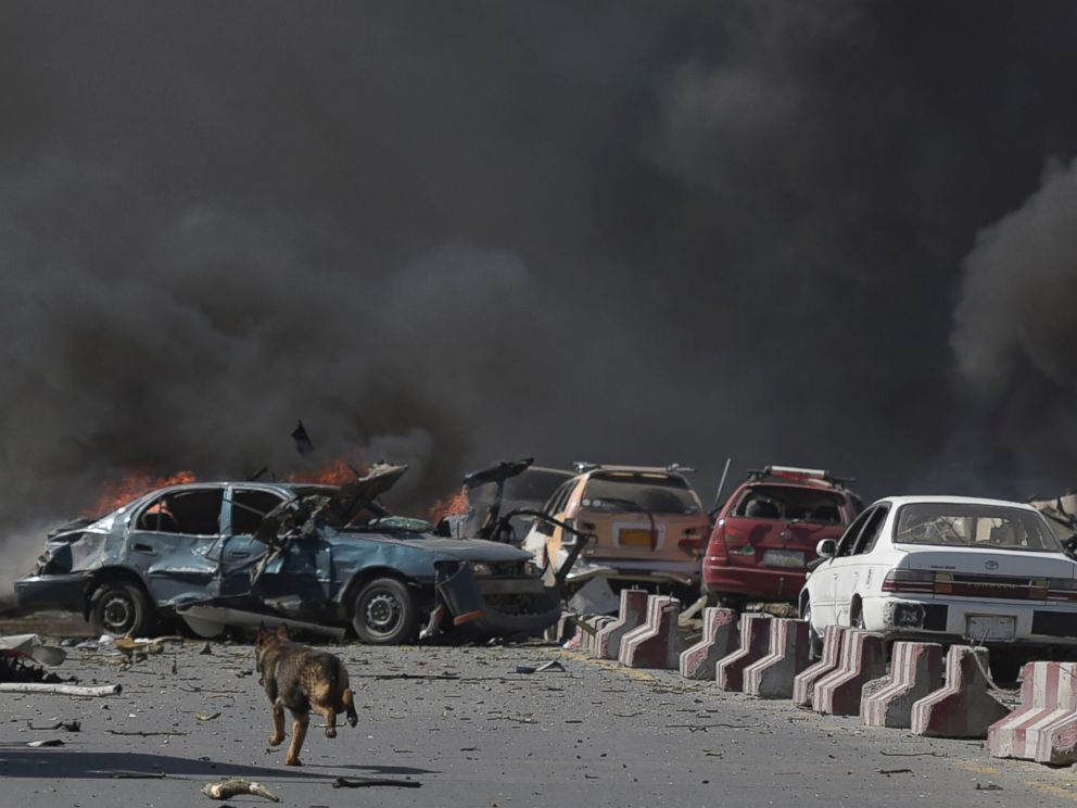 PHOTO: A dog is seen running at the site of a car bomb attack in Kabul, May 31, 2017.