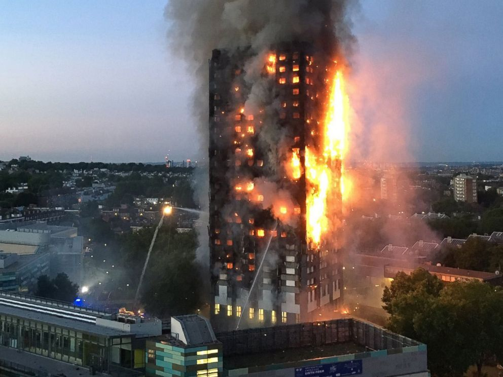 PHOTO:This handout image received by local resident Natalie Oxford early, June 14, 2017, shows flames and smoke coming from a 27-story block of flats after a fire broke out in west London. <p itemprop=