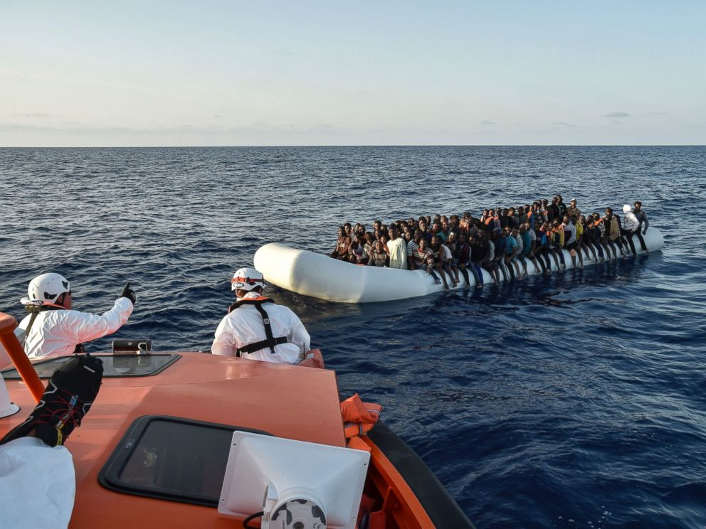 PHOTO: Migrants aboard a rubber boat wait to be rescued by the Maltese NGO Moas and the Italian Red Cross off the Libyan coast in the Mediterranean Sea, Nov. 3, 2016.