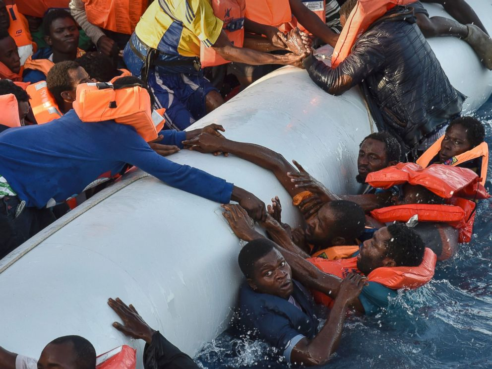 PHOTO: Refugees panic as they fall in the water during a rescue operation off the Libyan coast in the Mediterranean Sea, Nov. 3, 2016.