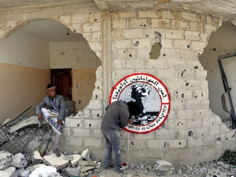 PHOTO: Yemeni graffiti artist Murad Subay creates a piece on a wall to commemorate the victims who were killed in Saudi-led coalition airstrikes in Sanaa, Yemen on June 13, 2015.