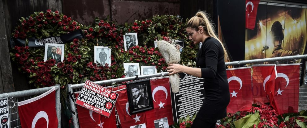 PHOTO: A woman lays flowers by a makeshift memorial in front of the Reina nightclub in Istanbul on Jan. 17, 2017, a day after Turkish police arrested the suspected attacker.