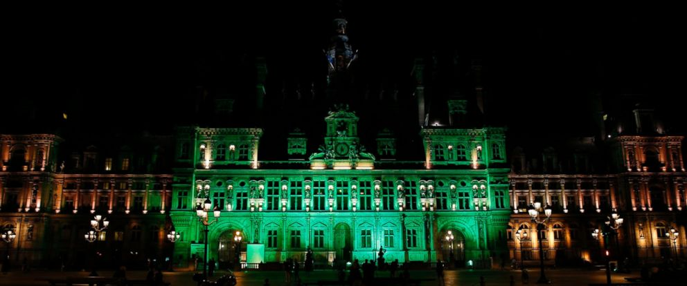 PHOTO: The City Hall of Paris is illuminated in green following President Donald Trumps announcement that the United States will withdraw from the 2015 Paris Climate Accord and try to negotiate a new global deal on climate change, June 1, 2017.