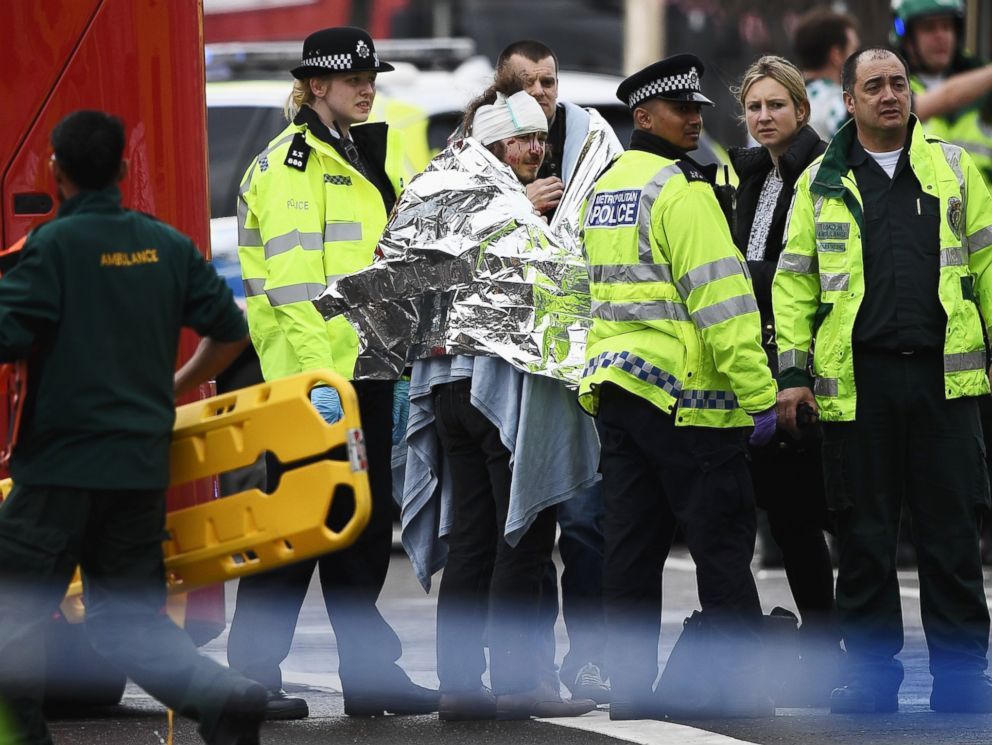 PHOTO: A member of the public is treated by emergency services near Westminster Bridge and the Houses of Parliament on March 22, 2017 in London.