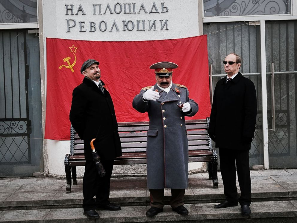 PHOTO: Performers dressed as Vladimir Lenin and Joseph Stalin stand in central Moscow on March 3, 2017.