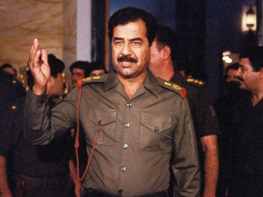 PHOTO: Saddam Hussein welcomes people In Baghdad, Oct. 17, 1983.