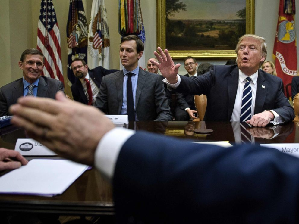 PHOTO:General Mike Flynn (L), Jared Kushner (2L),John Kelly (R) and others listen while US President Donald Trump speaks at the beginning of a meeting on cyber security in the Roosevelt Room of the White House, Jan. 31, 2017, in Washington.