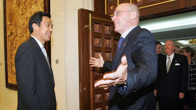 PHOTO: U.S. Treasury Secretary Henry Paulson greets Chinese Commerce Minister Bo Xilai at the Ministry of Commerce in Beijing, China, Sept. 21, 2006.