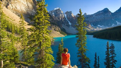 PHOTO: Woman sitting on rock at Lake Moraine.