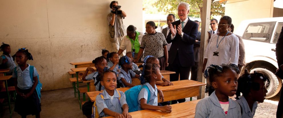 "PHOTO: Bill Clinton visits young students at a school in Port-au-Prince, April 08, 2011, introducing a new Clinton Foundation effort by launching the National Cholera Education and Awareness Campaign, ""Lavi san Kolera"", (Life Without Cholera)."