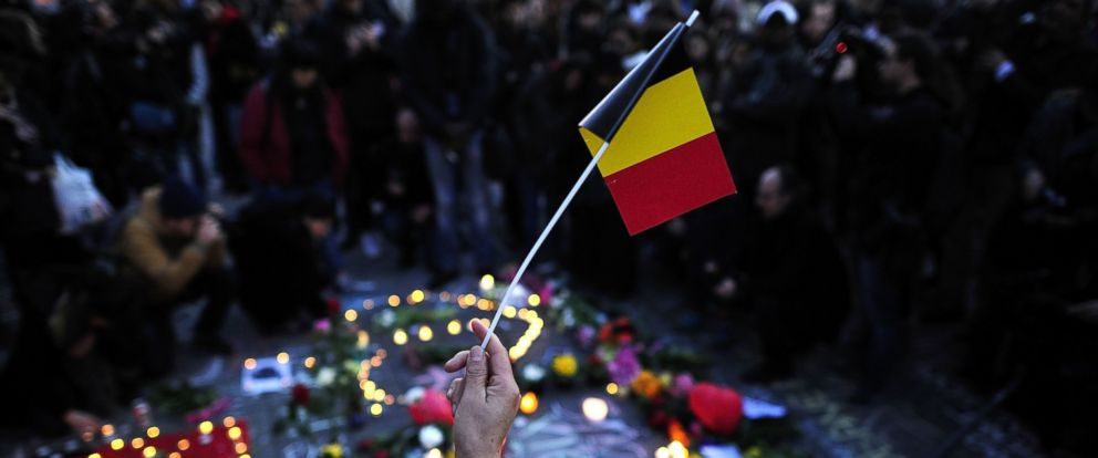 PHOTO: A local holds a paper national flag of Belgium at Beursplein square following the attacks on March 22, 2016 in Brussels, Belgium.